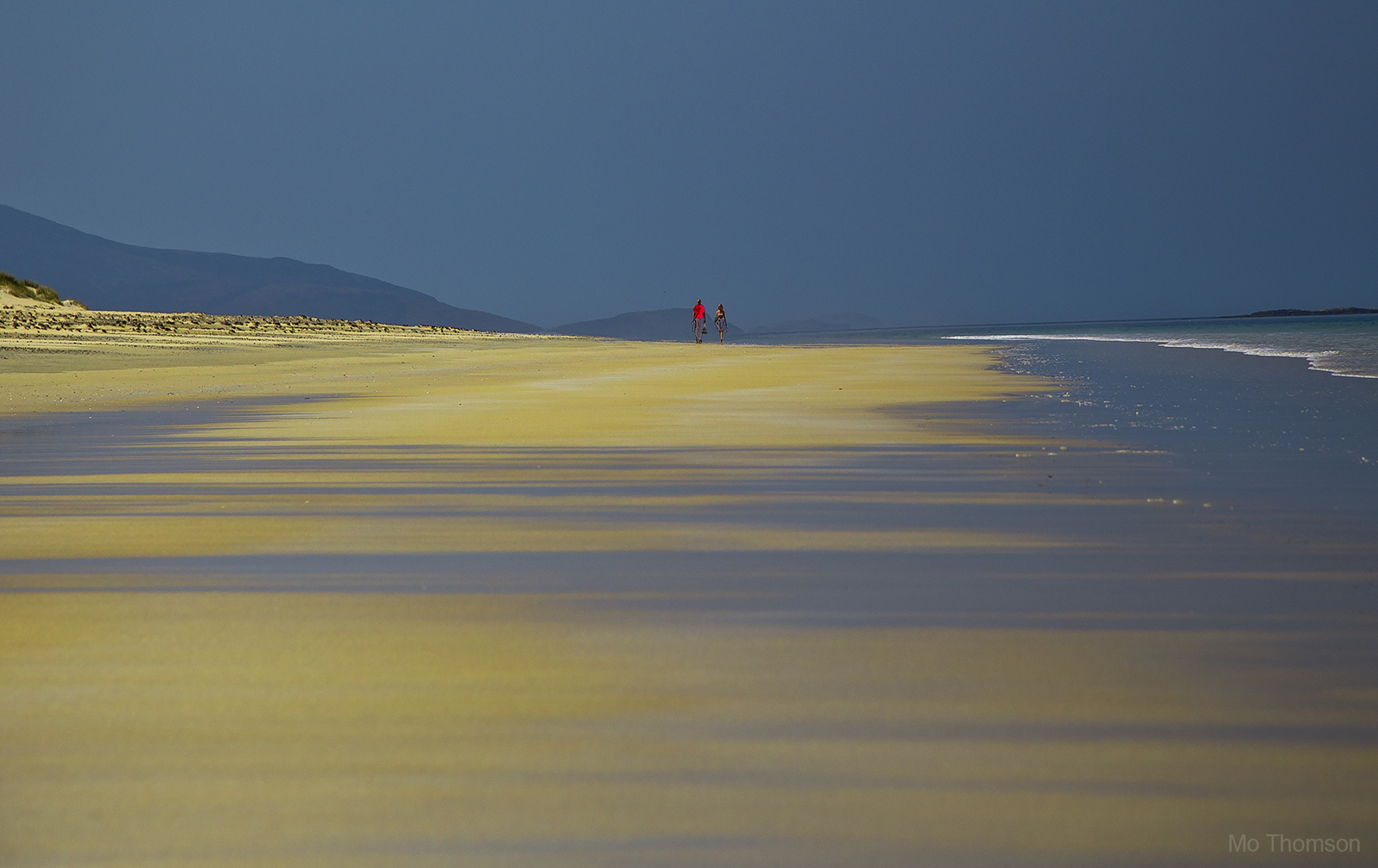 Couple walking along Luskentyre beach