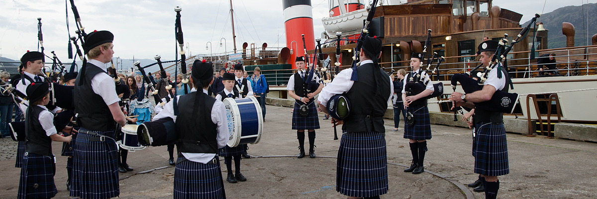 The Lochalsh Junior Pipe band welcoming PS Waverley to Kyle of Lochalshf