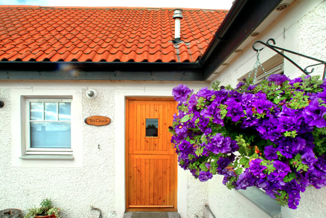 The doorway of one of Boll Holiday Cottages