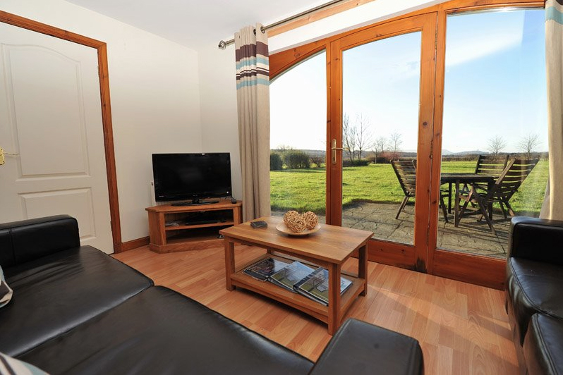 One of the cottages' sitting rooms, leather sofas